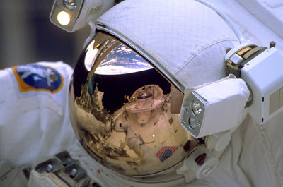 A modern day astronaut - The visor would conceal his face, just as seen in the carvings.jpg