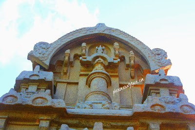A rocket space craft at the center of the tower.Mahabalipuram India.jpg