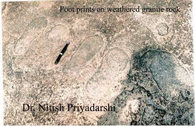 Human Footprints on granite rock