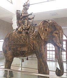 Karikal chola astride Elephant.image.